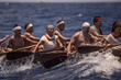 Maria Beatrix del Perpetuo Socorro Solis Ramirez, center, rows with her teammates during the Sacred Mayan Journey.