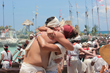 Two canoeists embrace after completing the Sacred Mayan Journey. They trained for six months to participate in the row.