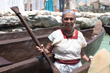 Maria Beatrix del Perpetuo Socorro Solis Ramirez smiles for the camera after completing the Sacred Mayan Journey. She was the oldest canoeist who participated in the row.
