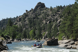 A raft exits Zoom Flume rapid in Browns Canyon of the Arkansas River in Colorado.