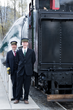 Volunteer Conductors prepare to board passengers at Mt. Rainier Scenic Railroad and Museum