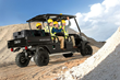 The rental-ready Carryall 1700 utility vehicle carries two crews and their gear with a cargo bed for an air compressor or other equipment.