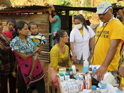 Medical doctor from India and nurse from Australia provide medical care in Nepal as part of the Scientology Disaster Response.