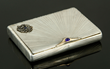 Russian Faberge cigarette case, silver with diamonds, sapphires, and 14K yellow gold