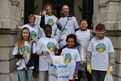 "Members of the Brussels branch of the Churches of Scientology for Europe's Way to Happiness club give the precept ""Safeguard and Improve Your Environment"" a cheerful thumbs-up."
