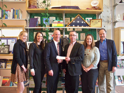 Kevin Hanna of AT&T presents a check to ProLiteracy staff. The contribution will support a joint financial literacy project with AT&T, ProLiteracy, and WCNY.