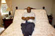 Easy Rest adjustable bed Win-A-Bed Sweepstakes winner, Leslie Harris, pictured in his new adjustable bed.
