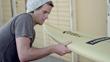 Professional Surfer Nic Lamb Examining a Big Wave Surfboard Featuring DuPont™ Kevlar®