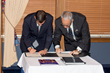 Ronald Christaldi, Shumaker attorney and Greater Tampa Chamber of Commerce chair, and Robert St. John, president of the American Chamber of Commerce Panama, signing the historic memorandum of understa