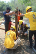 Volunteer Ministers drive in a pole that will serve as a support for temporary housing in Nepal in the wake of a series of destructive earthquakes and aftershocks in the Asian nation.