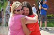 Mother Lisa Caviness hugs daughter and 2015 Remember the Removal Bike Ride participant Haylee Caviness before the group left to begin three-week journey.