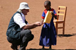 Human Rights Hero Maurizio de Romedis, who was honored at the Eighth Annual Human Rights Hero Awards on May 8, visits with a young villager. (Photo courtesy of ilvescovado.it)