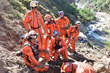 Héctor Méndez, founder and president of Los Topos Aztecas (seated at the left) directs his team in searching for bodies buried in a ravine in the mountains in Nepal in the aftermath of the April 25 earthquake.