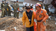 El Chino (as Méndez is known, at right), in Japan in 2011 to help in the rescue effort following the devastating earthquake and tsunami.
