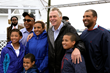 Gov. Terry McAuliffe poses with Phillip Haynie, a local community and business leader and close colleague to Omega Protein, and family in Reedville, Va.