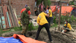 Working with the Canadian Army, Volunteer Minister-trained Scouts are setting up tents in a Kathmandu suburb where most of the buildings have been destroyed.