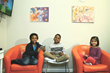 Photo of children playing on tablets at Take a Break Playcare