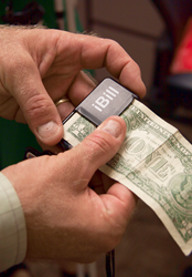 A dollar bill scanner can help Veterans with low vision in their everyday lives.