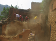 CINAT members and Volunteer Ministers work together to demolish the temple walls left severely damaged by the series of earthquakes and aftershocks in Kathmandu, Nepal.