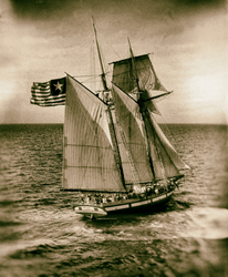 "Replica of ""The Invincible"" flying the Hawkin's Flag of the new Republic of Texas in 1836"