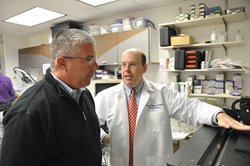 Sean Barnett, MD, MS, FACS, FAAP, Chief Medical Officer at Kaleidoscope and President and Medical Director of Ascend, discusses product design at the innovation center with Bryan Bucklew, President and CEO of Greater Dayton Area Hospital Association.