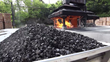 Photo from the Rick Yard at Jack Daniel's Distillery in Lynchburg, Tennessee. Pallets of sugar maple are burned to make charcoal used for mellowing whiskey.