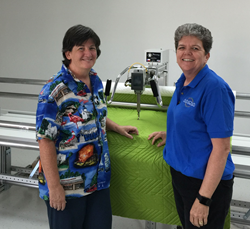 Carol Alperin, owner of Upstairs Quilting (left), with Michelle Eno, General Manager of the Southeast Division and Director of Sales for the Longarm Network.