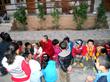 Students sitting with Principal Li, a buddhist nun who runs the school.