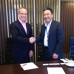 Image of Meiji President, Hiroki Sugiwaki and DTx VP, Brad Jens Signing Partnership Agreement