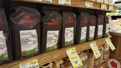 Organic coffee roasted by Crimson Cup Coffee & Tea on the shelves at an Earth Fare grocery