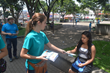 A young volunteer hands out The Truth About Drugs booklets.