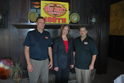 Beef Jerky Outlet COO Paul Lyons and President Scott Parker sell 100th franchise.