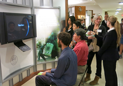 Visitors to the Church of Scientology Los Angeles World Environment Day forum and open house watch video presentations in the Church's Public Information Center.