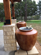 A pair of small, 160-gallon Ong™ jars installed by the entryway of an Austin-area home.