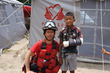 Rescue team member and Nepal child with arm in cast.