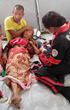 A Nepalese woman receiving first aid.