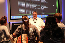 EMCC Instructional Computing faculty, Larry Heinz, explains cybersecurity to high school students.