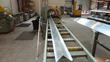 Custom Profiles Ltd's aluminium extrusion saw in operation in Bristol, UK