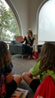 Kaili Harding, Ms. Illinois Galaxy 2015, reads a book to a group of children. Harding is also the president of the Schaumburg Business Association.