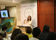 Social Reform Officer of the Church of Scientology of Mexico  welcomes guests to World Environment Day celebration.