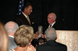 Coach Pulliam helps induct quarterback Vinny Testaverde into the Fork Union Military Academy Sports Hall of Fame in 2009.