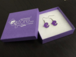 "EpilepsyStore.com sells unique, branded jewelry items such as these purple ""e"" ribbon awarness earrings."