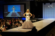Actress & Her Universe Founder, Ashley Eckstein, on stage at last year's fashion show in her Studio Ghibli Totoro gown. Eckstein will once again be hosting the 2015 Her Universe Fashion Show July 9th.