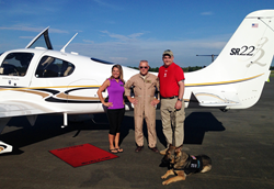 (From l-r) C.J. Bannister, Colonel Ben Knisely, Corporal Thomas Cannon and service dog Camo at the Sheltair Aviation facility at the Ocala International Airport prior to takeoff
