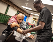 Jeff Mayweather wraps Abdallah's hands before a title fight.