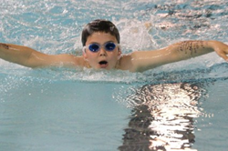 Boy wearing goggles in swimming pool