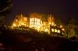 Highlands Castle at night overlooking Lake George and surrounded by the Adirondacks