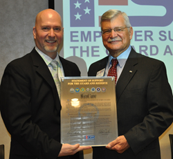 Major General (Retired) Bob Silverthorn presents ResCare Chief Human Resource Officer Richard Ivey with a plaque commemorating ResCare's statement of support for the Guard and Reserve.