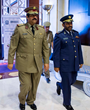 Staff Brigadier (Pilot) Mohammed A. AL-Mannai, Director, Qatar National Security Shield Project (right) receives official support for QMARSEC from H.E. Maj. Gen. Hamad bin Ali Al-Attiyah Minister of S