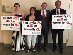 Cardiac arrest survivors Ellie Whelan (left), Ginnie Gick and David Belkin (right), with committee member, Tom Aufderheide, MD, of the Medical College of Wisconsin